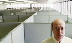 A man standing in an empty office